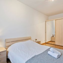 master bedroom in furnished two bedroom apartment near bois de la cambre