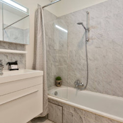 bathroom with shower and bath and fortnightly cleaning