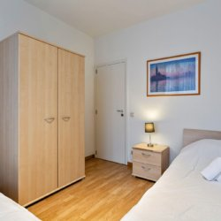 second bedroom with single bed and wardrobe for storage