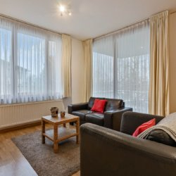 spacious living and dining room in two bedroom furnished apartment